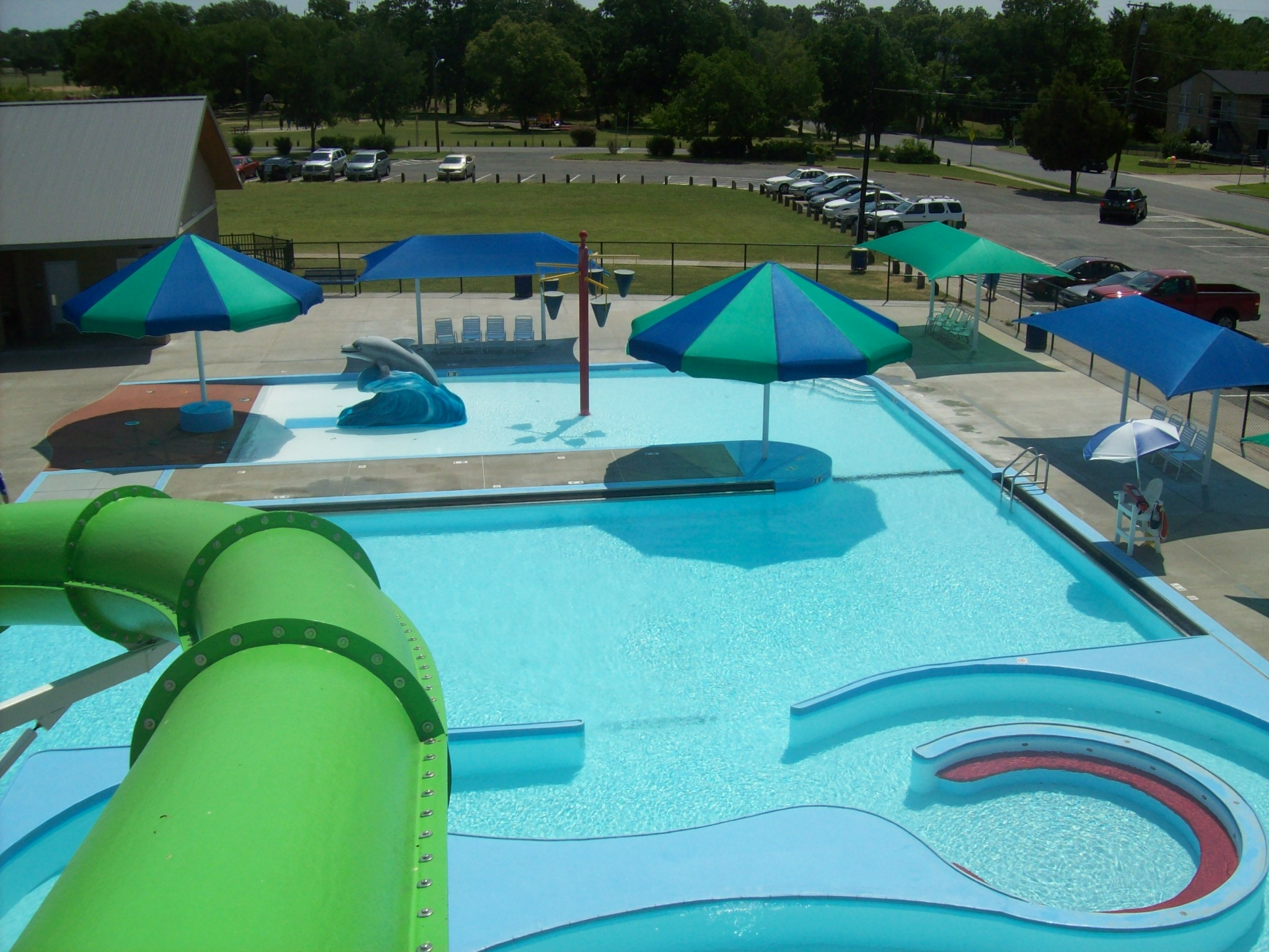 Overhead view of waterslides, pools, and umbrellas.